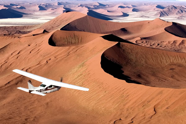 safari vol namibie exclusif jamais vu nouveau dunes de sable océan luxe